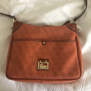 Rust colored Dooney and Burke purse